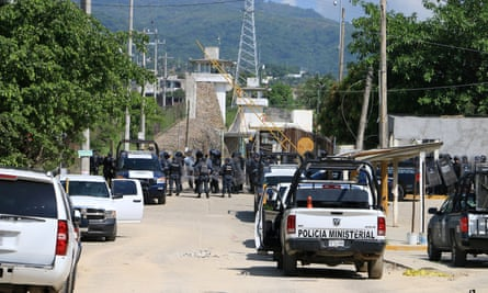 Riot police line up outside a prison after a riot broke out at the maximum security wing in Acapulco, Mexico, on 6 July.