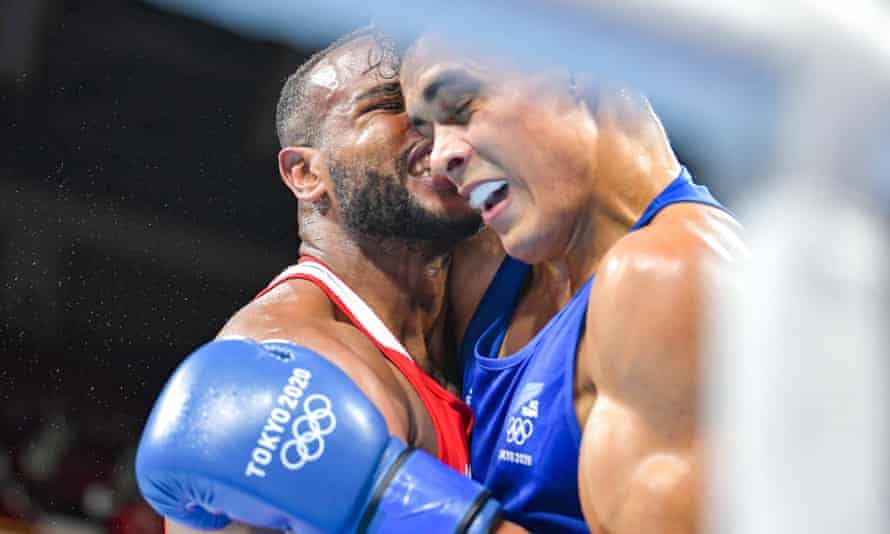 Morocco's Youness Baalla (red) tried to bite New Zealand's David Nyika during their heavyweight bout at the Kokugikan Arena in Tokyo.