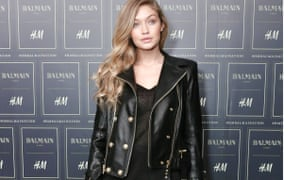 Gigi Hadid wears a biker jacket at the Balmain x H&M Collection Launch in October.