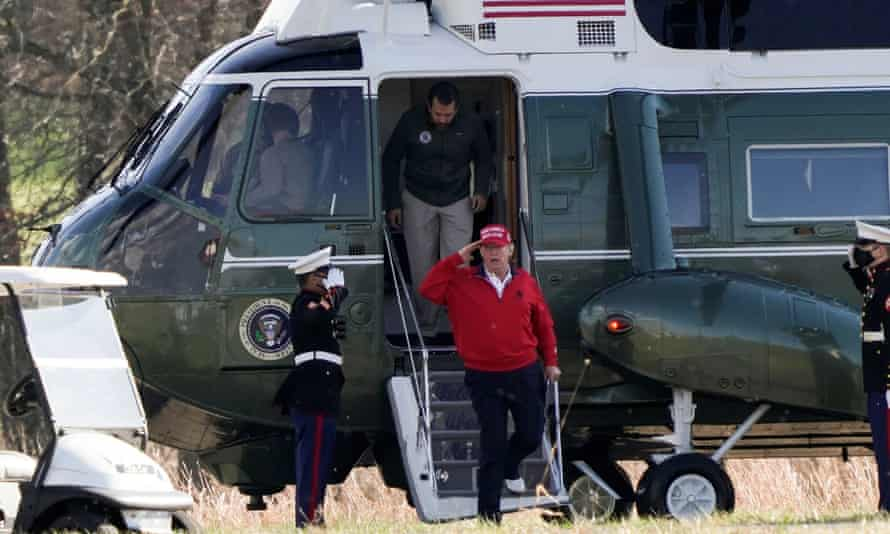 Donald Trump walks out of Marine One before a round of golf on Saturday