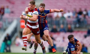 George Williams of Wigan Warriors is tackled by Rémi Casty of Catalans Dragons during the Super League match in Barcelona.