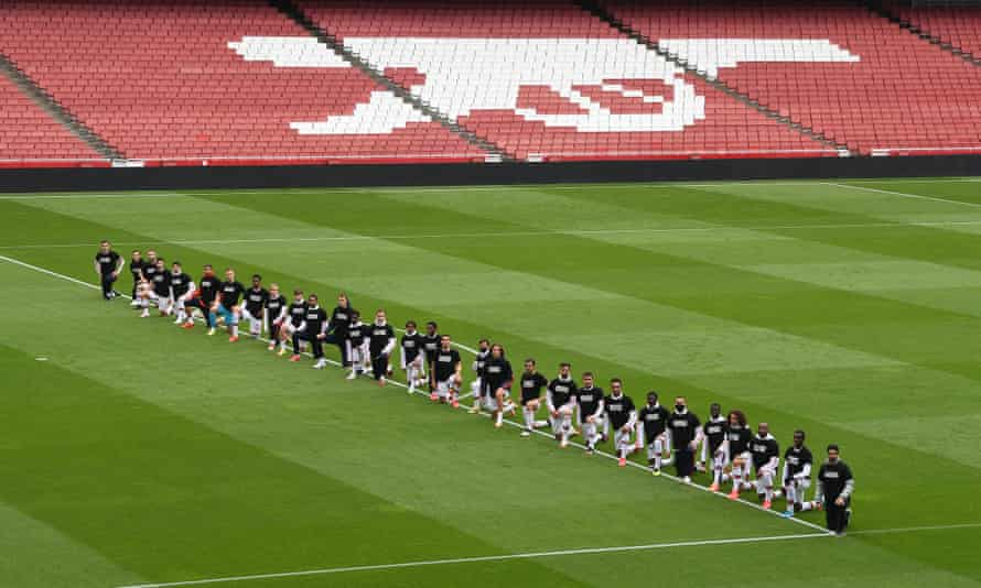 Arsenal players take a knee before their friendly against Brentford earlier this week.