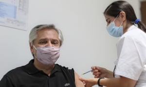 In this photo released by Argentina's presidential press office, Argentina president Alberto Fernandez gets a shot of the Russian vaccine in Buenos Aires on Thursday.