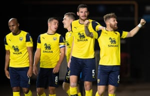 Matty Taylor of Oxford United celebrates his goal with team-mates.