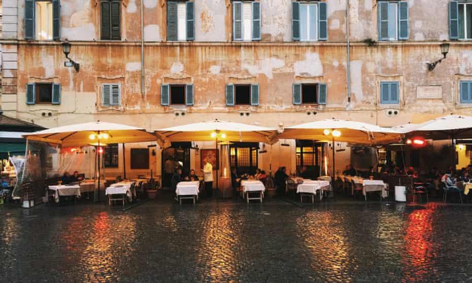 Restaurant patio at Piazza Santa Maria in Trastevere, Rome, Italy.