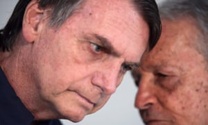 Brazilian far-right presidential candidate Jair Bolsonaro (L) speaks with Robson Gracie