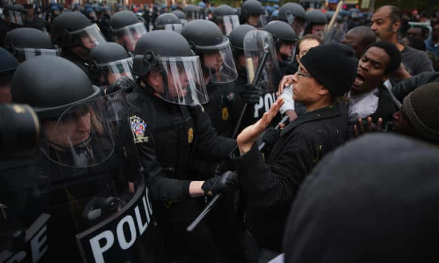 Protesters clash with police during a march in honor of Freddie Gray on 25 April 2015 in Baltimore.