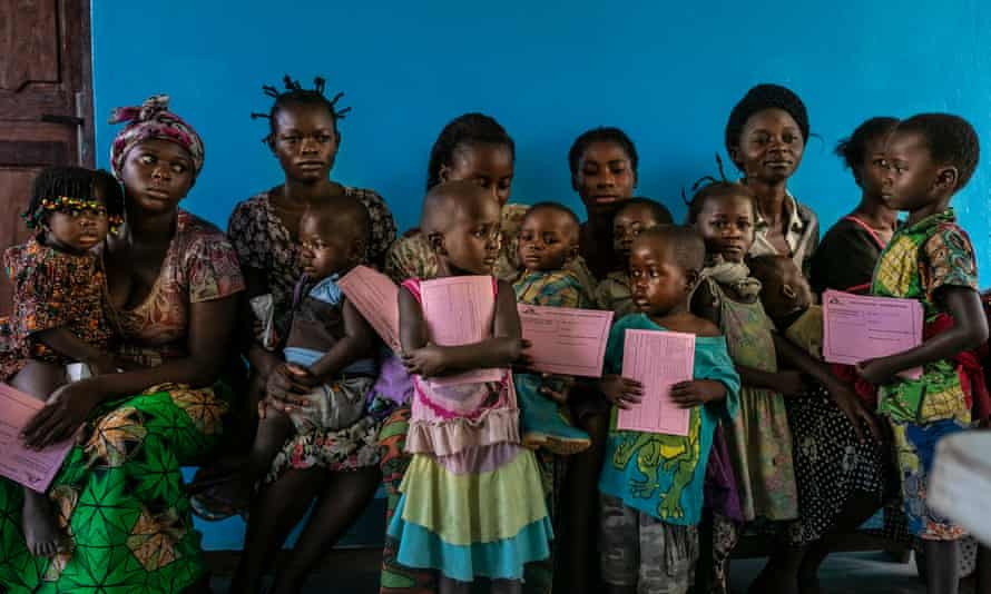 Children await measles vaccinations at the Lunyeka health centre on the first day of the inoculation campaign in the Democratic Republic of the Congo
