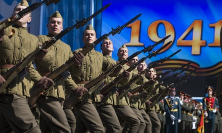 Russian army soldiers, dressed in uniforms from the second world war, march in Red Square during the rehearsal.