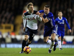 Chelsea's Gary Cahill hauls Christian Eriksen to the ground and ends up in the ref's book.