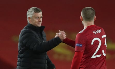 Manchester United's manager, Ole Gunnar Solskjær, with Luke Shaw after the 5-0 win against RB Leipzig in the team's most recent match.