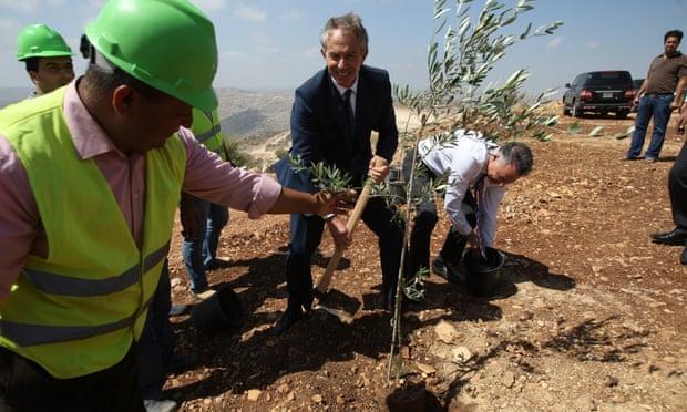 Tony Blair plants an olive tree at Rawabi in June 2010.
