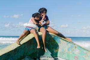Two young girls pose for a photo on the top of a pool, in the neighborhood of La Perla in the Old San Juan, Puerto Rico. November 2nd, 2019. © Adriana Parilla Growing up It was difficult for me to see myself as a young black girl because I was constantly reminded by other kids that black girls were ugly because of the color of their skin. I became extremely shy and my only escape was to to turn away and hide.