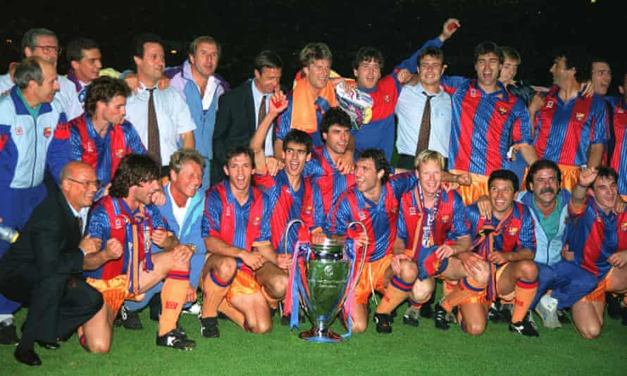 Pep Guardiola holds his medal aloft in front of Johan Cruyff after Barcelona's European Cup win in 1992.