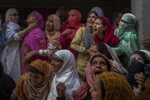 Srinagar, India Relatives and neighbours wail during the funeral of Waseem Ahmed, a police officer who was killed in a shootout, on the outskirts of Indian-controlled Kashmir. Two civilians and two officers were killed in an armed clash triggering anti-India protests