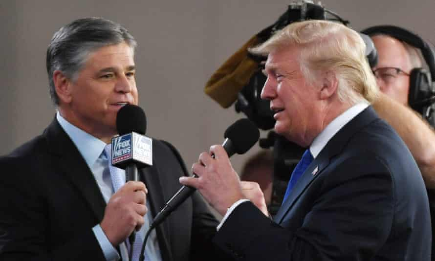 Fox News Channel and radio talk show host Sean Hannity interviews Trump at a campaign rally at the Las Vegas Convention Center