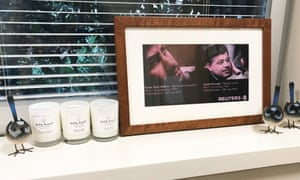 Framed photos of Namir Noor-Eldeen and Saeed Chmagh