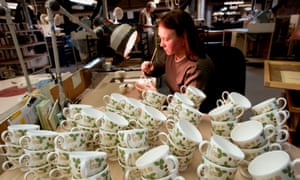 A female worker at the Wedgewood factory and pottery in Stoke on Trent England.