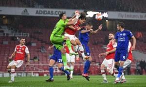 Arsenal's David Luiz heads clear.