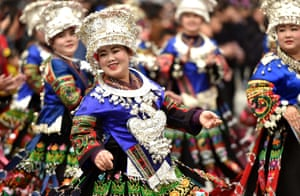Leishan County, China. Miao people dressed in traditional silver-decorated clothes and hats celebrate New Year