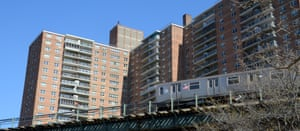 A subway train in front of Trump Village at Coney Island, Brooklyn.