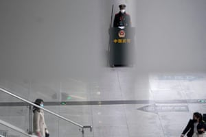 A paramilitary police officer wears a mask at Shanghai railway station.