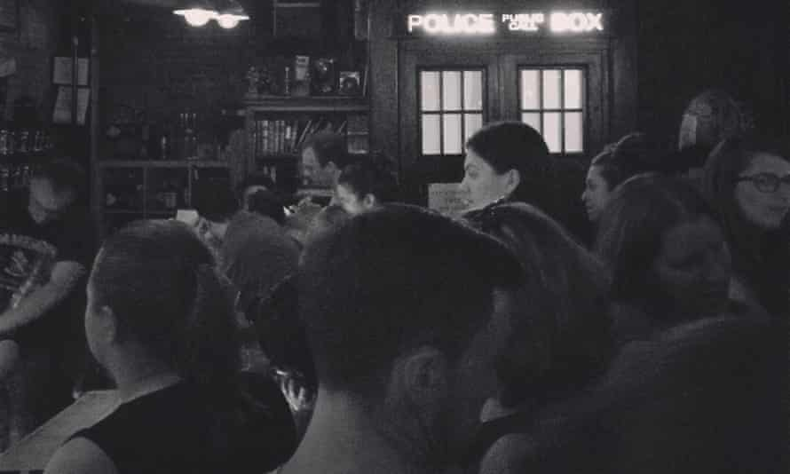 The crowd around the bar right next to the Tardis, which hides the bar's bathroom. In far left, Andy Heidel is stacking glassware behind the bar.