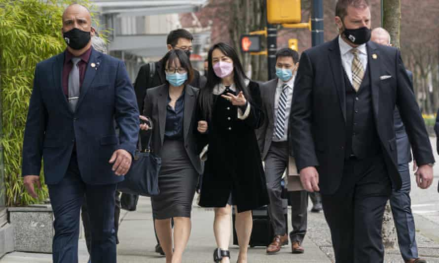 Meng Wanzhou, center right, leaves British Columbia supreme court this month.