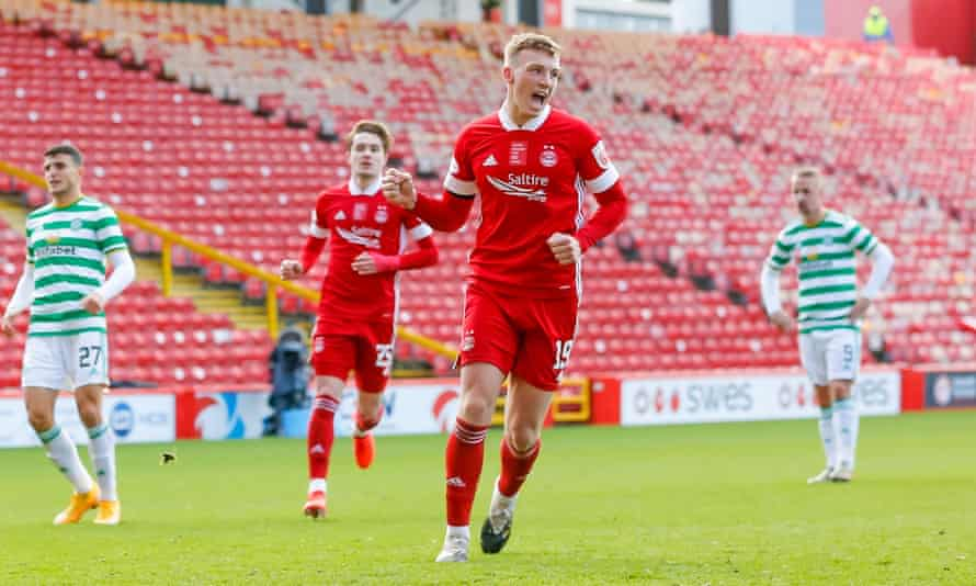 Lewis Ferguson celebrates scoring an injury-time penalty to secure a 3-3 draw for Aberdeen at home to Celtic
