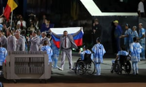 Andrei Fomochkin carries a Russian flag during the opening ceremony of the 2016 Paralympic Games.