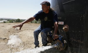 Joe Ben Jr tests the water from tanks at the Chief Hill location in Shiprock, New Mexico.
