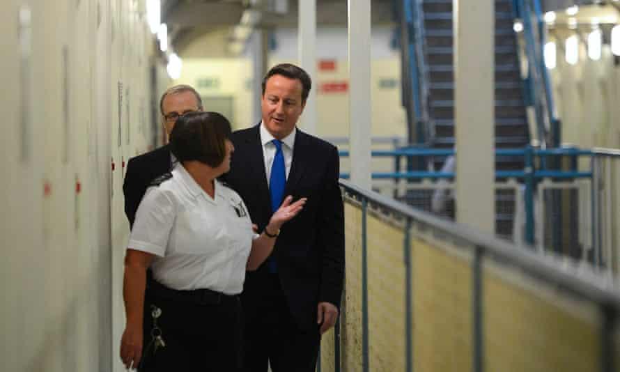 David Cameron on a tour of a prison