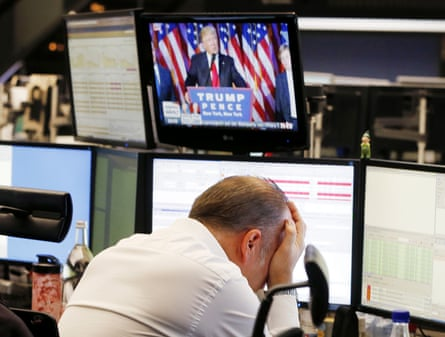 A broker reacts as President-elect Donald Trump appears on a television screen at the stock market in Frankfurt, Germany.