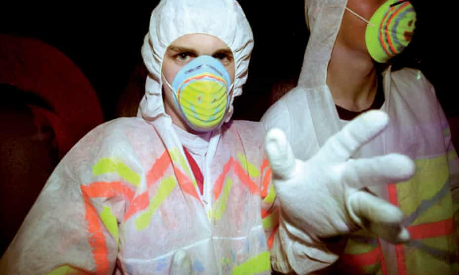 Two guys raving with face masks and white gloves