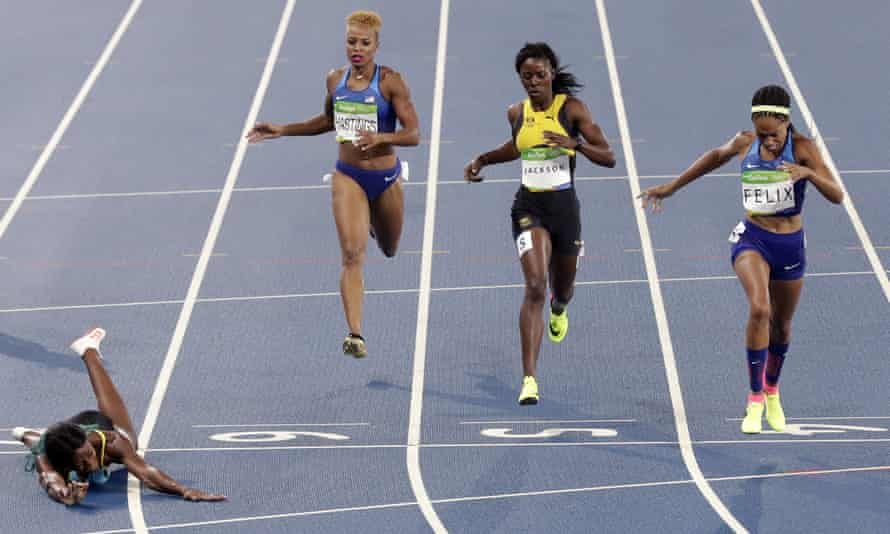 Shaunae Miller of the Bahamas falls over the line to capture the Olympic 400m title.