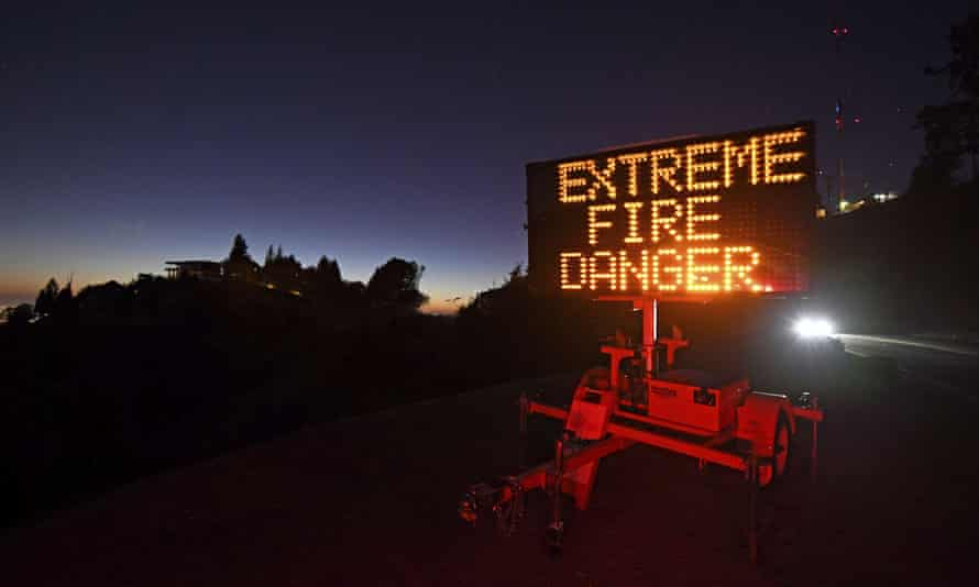 A roadside sign warns motorists of extreme fire danger on Grizzly Peak Boulevard, in Oakland, California, in October.
