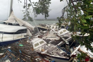 Witnesses described sea surges of up to eight meters and flooding throughout the capital. This photo shows storm damage to boats in Port Vila.