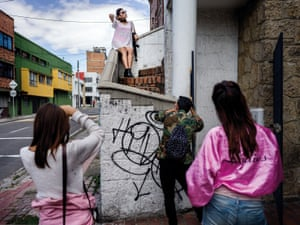 "A fashion shoot of a local brand 'Hunters Project Agency' in one of the wealthier neighbourhood in the North of Bogota. -The model Astrid Sanchez Pinada is holding a plastic AK47 in her hand. ""Fashion reflex whats happening in the world, our country and in our streets."" the fashion photographer explains upon questioning why they are using a gun."