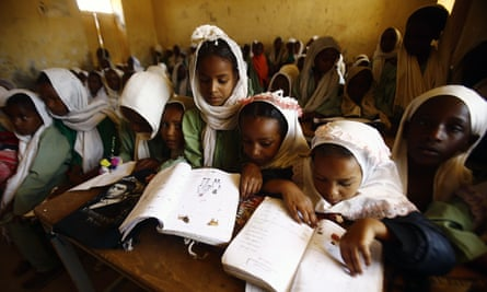 udanese girls sit in a classroom at at the El-Riyadh camp for internally displaced persons (IDP) in Geneina, the capital of the state of Sudan's West Darfur, on February 8, 2017. / AFP PHOTO / ASHRAF SHAZLYASHRAF SHAZLY/AFP/Getty Images
