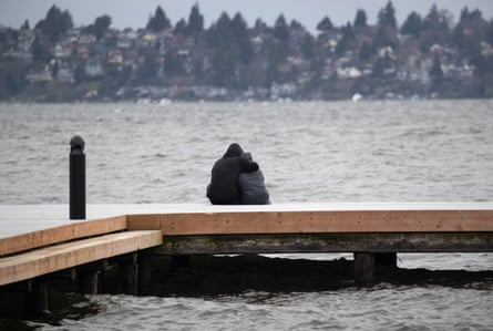 A couple gazes over Lake Washington on March 14, 2020 in Kirkland, Washington. As the coronavirus pandemic has spread, officials have advised social distancing from crowds to avoid contracting COVID-19.