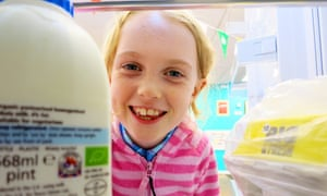 A girl examines a community fridge