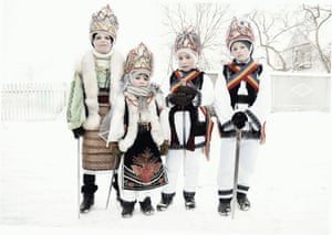 Childrens celebrate the winter festival of Malanka in Krasnoilsk. The holiday, which involves dressing in elaborate costumes and going from house to house as a group singing traditional songs, is celebrated on New Year's Day of the Orthodox calendar