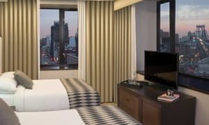 A view from a double room, showing lower Manhattan at dusk, at the Leon Hotel in New York.