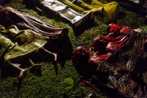 General news – singles, first prize. The bodies of Rohingya refugees are laid out after the boat in which they were attempting to flee Myanmar capsized off the coast of Bangladesh. Around 100 people were onboard; there were 17 survivors