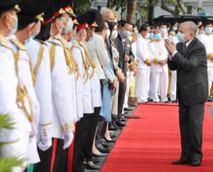The Cambodian King Norodom Sihamoni (R) greets diplomats during a ceremony at the Independence Monument in Phnom Penh.