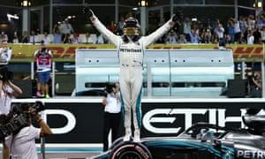 Lewis Hamilton celebrates his pole position at the Abu Dhabi F1 GP