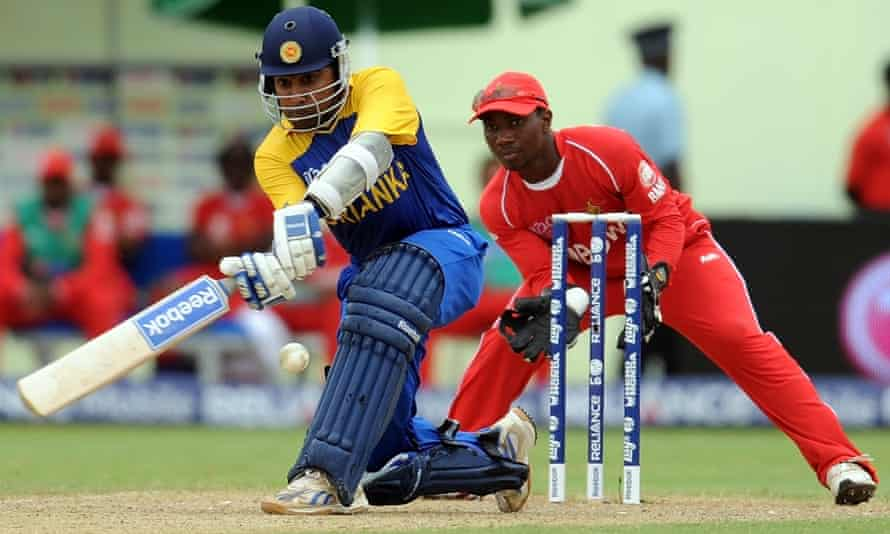 Taibu looks on as Sri Lankan batsman Mahela Jayawardene plays a shot during a 2010 T20 World Cup match for Zimbabwe in Guyana.