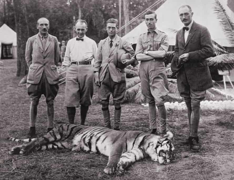The then Prince of Wales, centre, poses with a tiger he shot on a hunting expedition in Nepal, 1922.