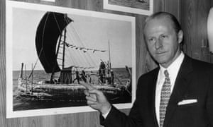 """Norwegian explorer and anthropologist Thor Heyerdahl points to a photo of himself on board a papyrus-reed raft which he used on his """"Ra Expeditions,"""" November 1970."""