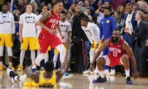 James Harden (13) celebrates after making the game-winning basket against Golden State Warriors forward Draymond Green (23) during overtime